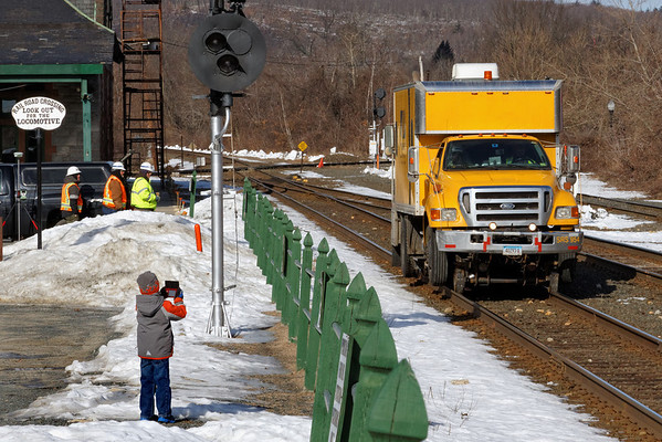 A young railfan shoots video of SRS truck 954 working at MP83, Palmer, MA. 2/21/2013 - 598C6598dK