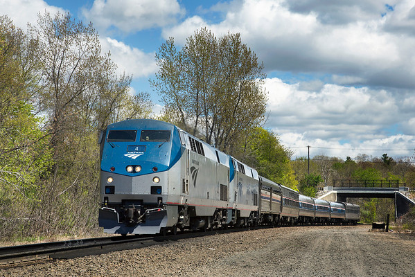 On a beautiful Spring day, Amtrak 449 is westbound through MP57, Charlton, MA with #4 on the point and NYC 448 bringing up the rear. 5/7/2013 - 598C9999aK