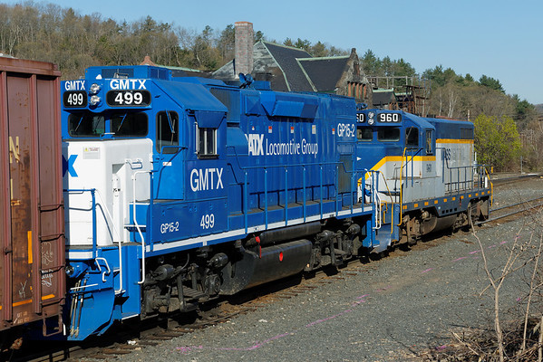 MCER 960 and GMTX 499 ease past the historic depot at MP83, Palmer, MA. 5/1/2013 - 598C9229dK