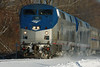 With a bad case of front end 'acne', Amtrak #88 leads train 449 through the new snow at MP57, Charlton, MA. 12-18-2013 - 598C1572dK