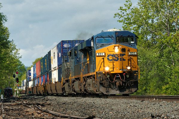 With CSX 831 leading two other units, train Q022 rolls past MP64, East Brookfield, MA with a long drag of stacks for Worcester. 5/19/2013 - 598C0195dK