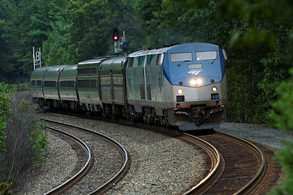 On a dark, showery afternoon, Amtrak train 449 comes through the S-curves at MP60, Spencer, MA on the CSX Boston Line. 7/25/2013 - 598C3281dK