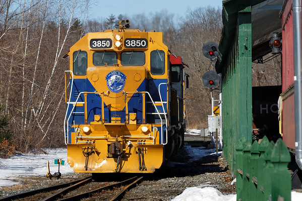 New England Central 3850, with three other units, pulls a long mixed freight south across the diamond into the NECR yard at MP83, Palmer, MA. 2/21/2013 - 598C6619dK