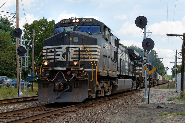 Westbound NS stack train at the Patterson Rd. crossing in Shirley, MA. Of course, just as the train approached, a big cloud covered the sun...8/16/2013 - 598C5826dK