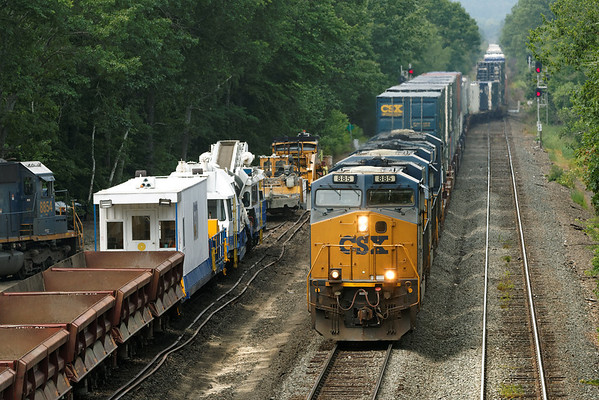 As the work begins at MP64, East Brookfield, MA, the tampers and the undercutter wait to take the main as Q022 rolls through with a long drag of stacks for Worcester. 6/23/2013 - 598C1006dK