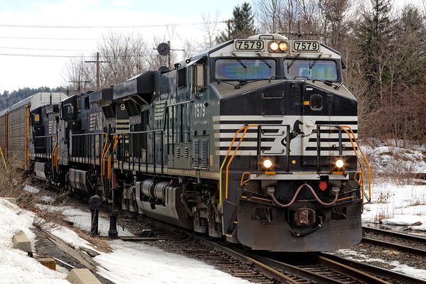 Powered by three big NS units, train 205 with 25 empty auto racks heads west through Gardner, MA. 3/13/2013 - 598C7335dK