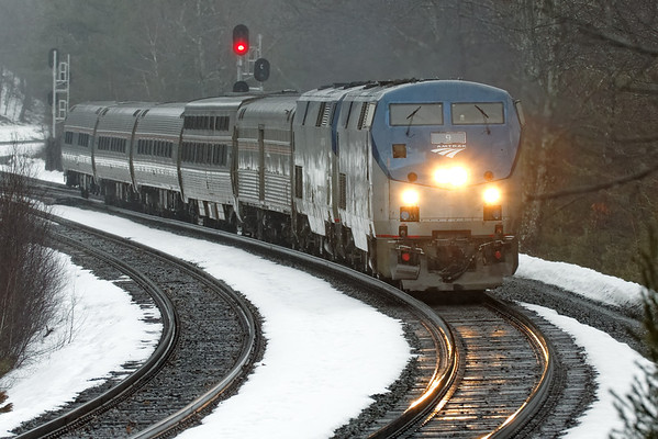 """It was a dark and stormy afternoon as Amtrak 449, with a rather beat up looking #9 on the point, heads through the """"S"""" curves at MP60, Spencer, MA. 2/27/2013 - 598C6834dK"""