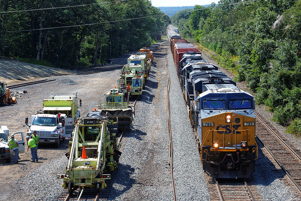 Q022 passes the track gang in the yard at MP64, East Brookfield, MA. 8/12/2013 - 598C5373dK