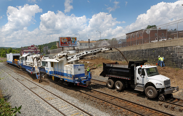 With the work finished on the main, undercutting continues on the siding track in the CSX yard at MP83, Palmer, MA. 6/17/2013 - 598C0756dK