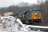 At MP57 in Charlton, MA, CSX train Q012 sneaks by the leftovers from our blizzard a couple of weeks ago. 2/28/2013 - 598C6841dK