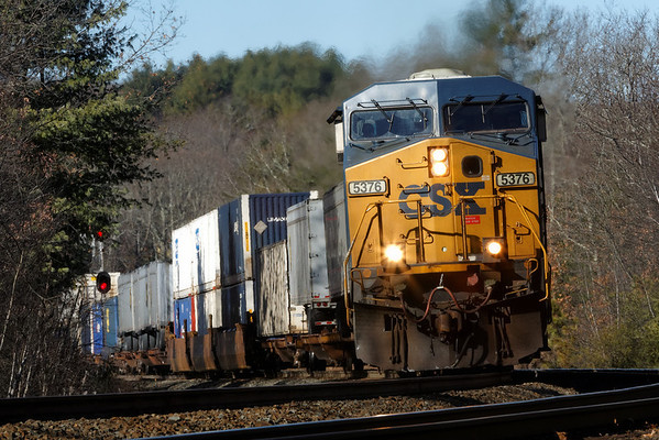 On it's way to Worcester with a long drag of double stacks and UPS trailers, CSX train Q022 cuts through the midday shadows at MP60 on the CSX Boston Line. 11/25/2013 - 598C1128dK