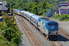 "For some reason, unknown to this poster, Amtrak's Vermonter today had no trailing power so it couldn't proceed west from Palmer, MA. The solution was train P930, consisting of engine #207, control car #9639 plus one additional car which came east from Springfield and tied on to the west end of the Vermonter and took it to Springfield. First time I've seen a ""helper"" in the middle of an Amtrak consist... 8/5/2013 - 598C4558dK_2"