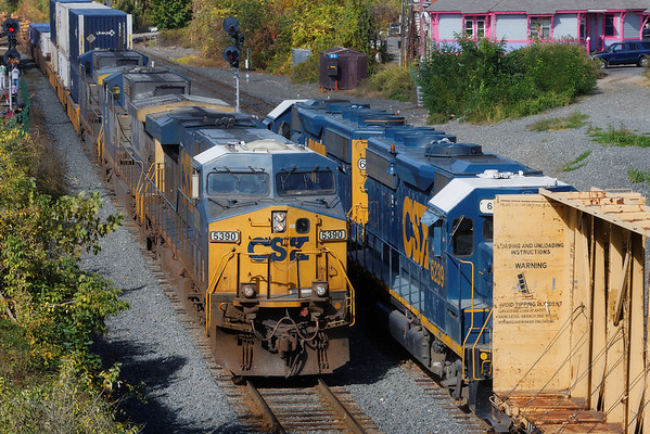With the Springfield local holding the siding, waiting to go west, CSX train Q022 rolls through MP83, Palmer, MA, on the main. 10/11/13 - 598C8737dK