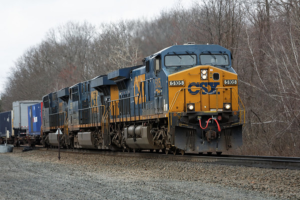 With a long drag of trailers/double stacks for Worcester, CSX train 022 rolls through MP57, Charlton, MA. 4/19/2013 - 598C9045dK