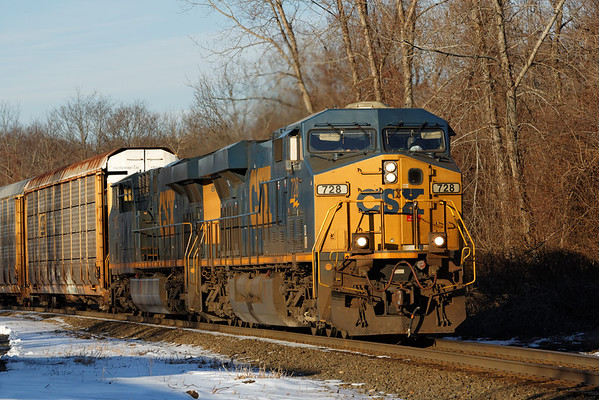 In gorgeous early morning winter light, CSX train Q264 heads up the Charlton Hill at MP57, Charlton, MA on the CSX Boston Line. 1/20/2013 - 598C5668dK