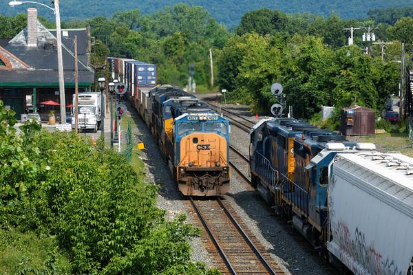 With train B740, the Springfield Local, holding the siding, train Q012 runs through MP83 in Palmer, MA. 7/29/2015 - 598C4980dK
