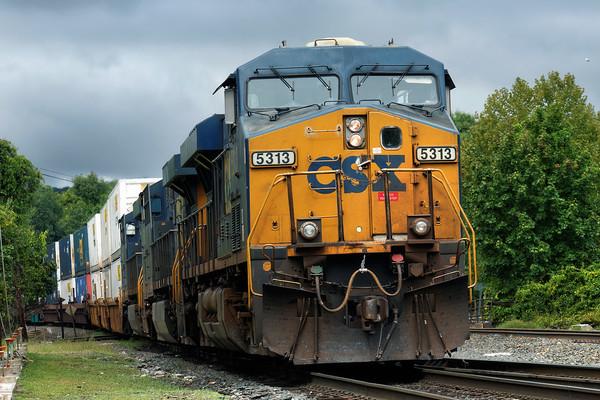 Eastbound under threatening skies, train Q022 rolls through MP83 in Palmer, MA.<br /> 9/11/2015 - 598C7980dK