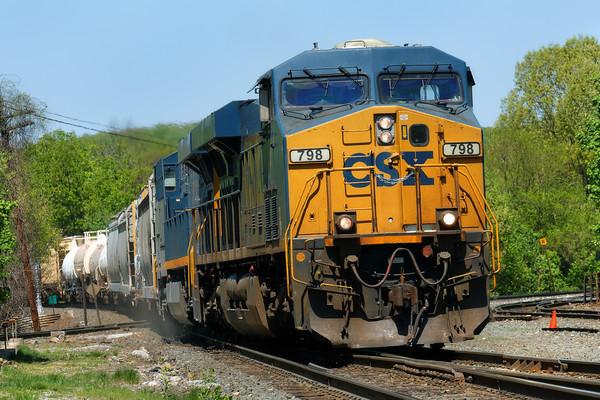 CSX train Q422 leaves a cloud of dust as it slams across the diamond at MP83 in Palmer, MA.<br /> 5/14/2015 - 598C7441dK