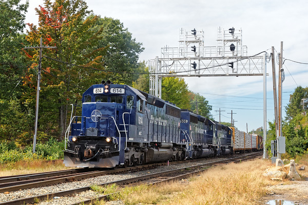 After westbound 23K cleared, EDPO heads out under the new signal bridge at the east end of the Gardner, MA yard.<br /> 9/21/2016 - 598C6135dK