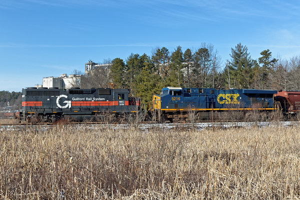 Guilford 319 and CSX 5216 pulling part of an empty grain train on the loop track at the Milling. 12/20/2016 - 598C9418dK