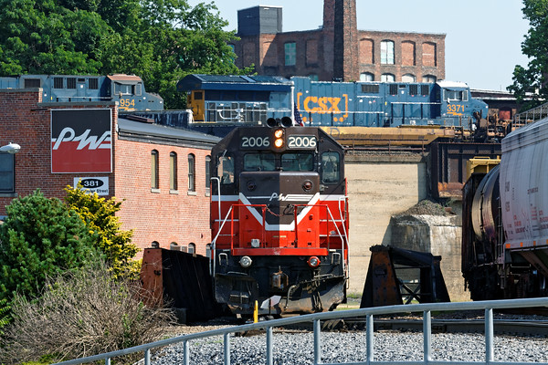 Almost a real over/under!<br /> Two P&W units hold the track near their Admin building as CSX train Q020 eases into Worcester over the old B&A bridge.<br /> 7/1/2016 - 598C9864dK