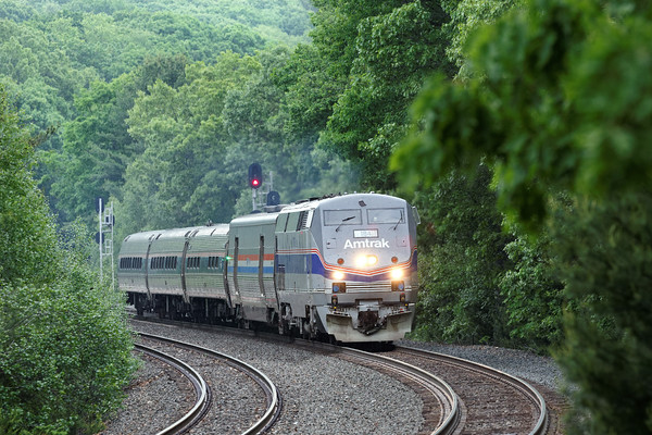Under showery skies, Amtrak 184 leads train 449, the Lake Shore Limited, through the lush Spring foliage along the S-curves at MP60 in Spencer, MA.<br /> 6/5/2016 - 598C8751dK