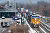 Just a hint of winter - showing traces of the white stuff, CSX train Q022 eases across the diamond and past the historic depot at MP83 in Palmer, MA.<br /> 12/22/2016 - 598C9501dK