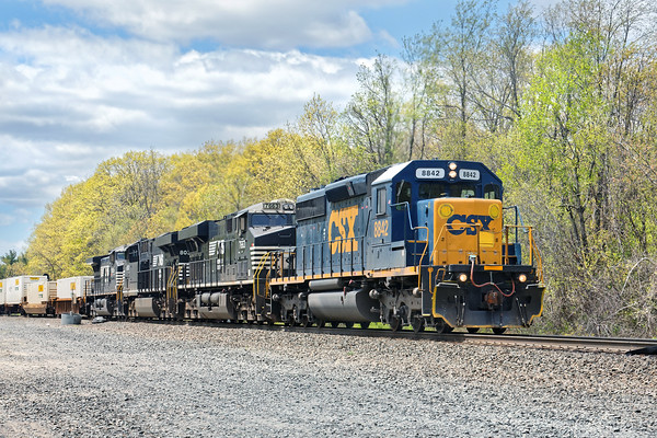 Due to the recent B&M/PAS derailment in Charlemont, MA, some of their trains are being rerouted on the B&A to Worcester then up the branch to Ayer. The first of these reroutes is train X800 (22K) seen here at MP57 in Charlton, MA with CSX 8842 leading NS 7663, NS 8030 and NS 9895 pulling 380 axles.<br /> Update - this ended up being the only PAS reroute due to the quick cleanup in Charlemont. Interesting to note that this train was all single stacks due to the original Hoosac Tunnel routing whereas normal traffic on the B&A is mainly double stacks.<br /> 5/16/2016 - 598C7954dK