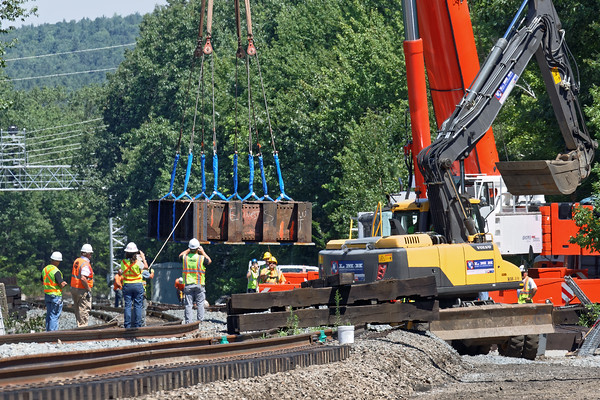 Work at Wachusetts continues - here a gigantic crane sets part of the highway underpass deck. 8/3/2016 - 598C2743dK