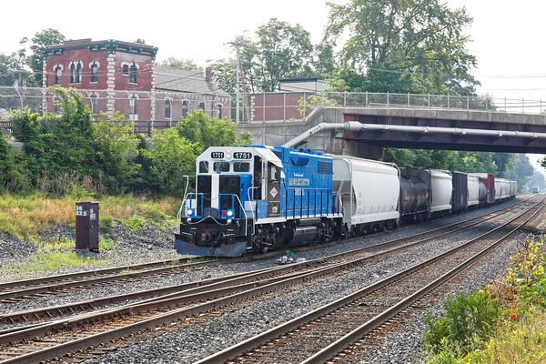 On a hot, hazy summer morning, Mass Central 1751 has finished it's switching duties and eases out of the CSX yard at MP83 in Palmer, MA.<br /> 7/7/2016 - 598C0200dK
