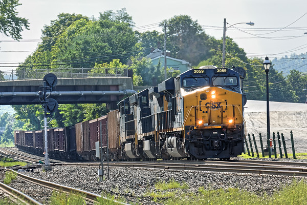 On a hazy, hot summer morning, CSX train Q031 heads west out of Palmer, MA with a cut of Herzog cars. 8/15/2016 - 598C3460d2K