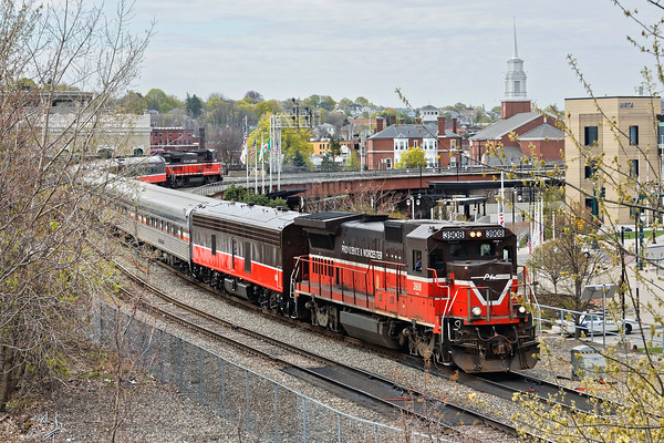 In downtown Worcester, the P&W passenger extra heads north towards the tunnel under the St. Vincent Hospital building and on up the branch to Gardner.<br /> 4/30/2016 - 598C7470dK
