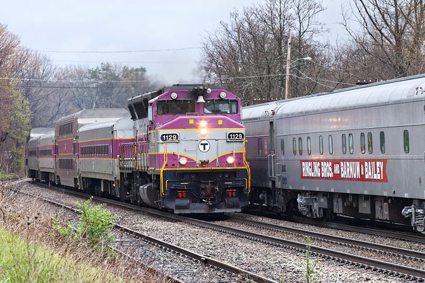 """Near the center of Ayer, an outbound """"T"""" commuter train passes the circus extra. 5/3/2016 - 598C7594dK"""