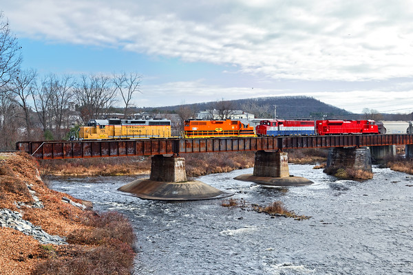 Colorful Consist!<br /> NECR heads north across the bridge at Three Rivers, MA with NECR 721 leading NECR 2048, NECR 3039 and freshly painted VTR 431dead in tow.<br /> 12/2/2016 - 598C8608dK