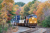 Running through the last vestiges of Fall color, train Q022 hits the S-curves at MP60 in Spencer, MA with CSX 3369 leading BNSF 3912 elephant style.<br /> 10/28/2016 - 598C7136dK