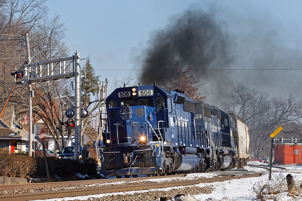 Doing it's best imitation of a steam engine, train POED blows through the center of Shirley leaving a cloud of carbon in the air.<br /> 12/14/2016 - 598C9296dK