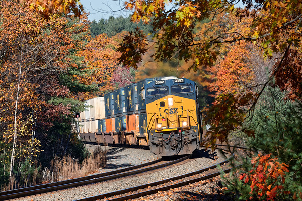 Against a backdrop of late Fall color, CSX train Q012 hits the S-curves at MP60 in Spencer MA.<br /> 11/1/2016 - 598C7343dK
