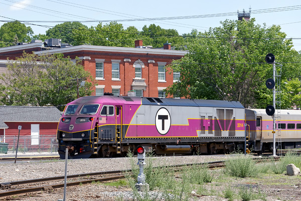 """An inbound """"T"""" commuter train running through Ayer with a backdrop of some of the historic buildings on Main Street. 6/6/2016 - 598C8848dK"""