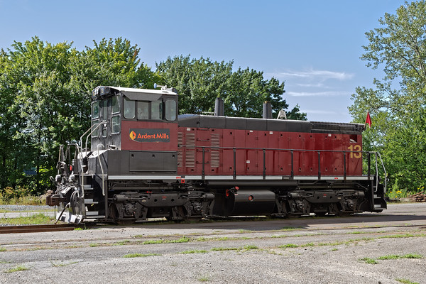 Ardent Mills #13, an EMD SW1500, was working the loop track at the milling. 8/3/2016 - 598C2624dK
