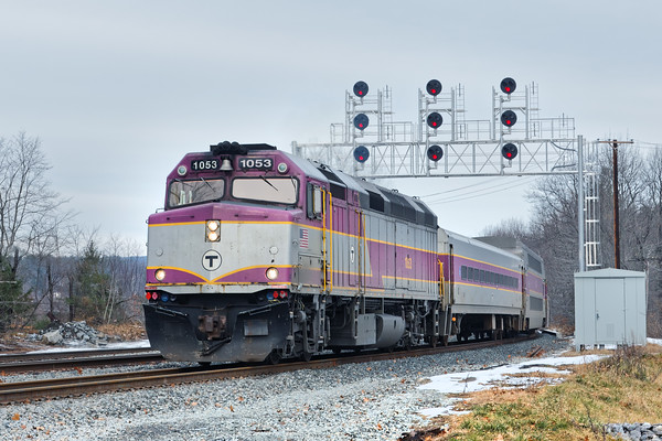 Running on pretty much a full schedule, a 'T' commuter train eases under the new signal bridge just east of the new Wachusett commuter station in Fitchburg. 12/8/2016 - 598C8993dK