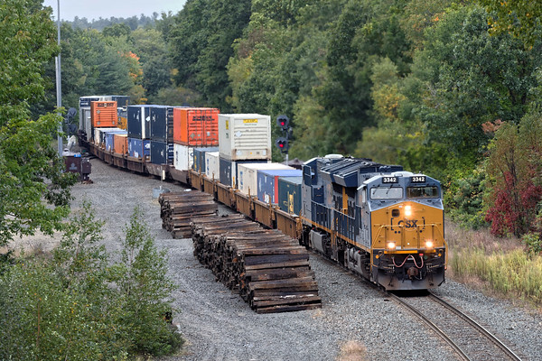 With train 426 in the hole on the siding, train Q012 takes the signal at MP57 and makes a run up the Charlton Hill.<br /> 9/30/2016 - 598C6311dK