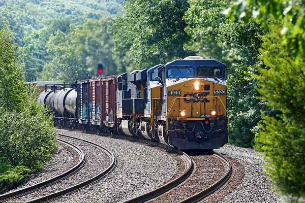 Running at track speed, CSX train Q427 (POSE on the Pan Am) hits the S-curves at MP60 in Spencer, MA. 7/1/2016 - 598C9892dK