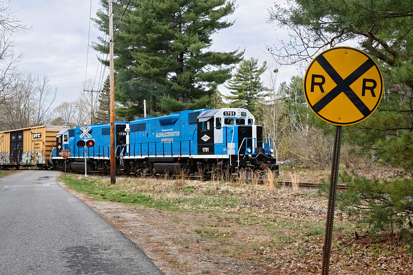 Country railroading - MCER freight crosses Bennett Road in Palmer, MA on it's way  north to Barre.<br /> 5/6/2016 - 598C7689dK