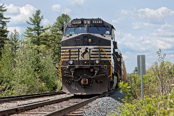 In Ayer, train 28N, with a long string of loaded auto racks, sits on the main at Wagon Wheel. 5/20/2016 - 598C8276dK