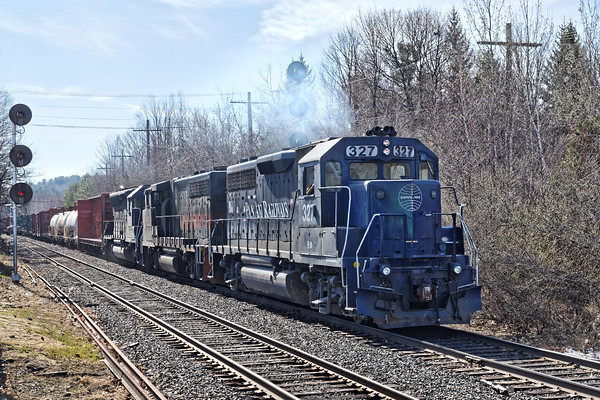 On track 2, Pan Am train POED eases down the hill into the Gardner, MA yard. 4/21/2016 - 598C6991dK