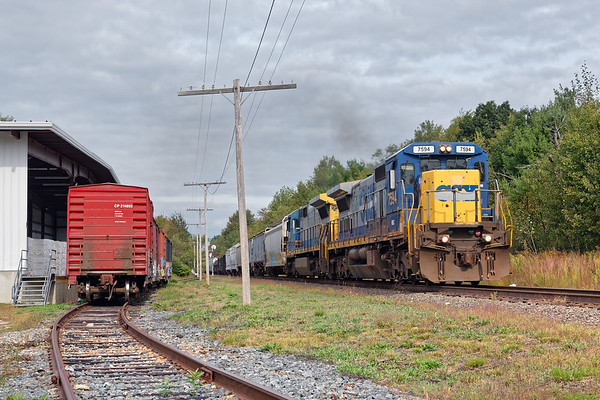 With brand-new-used C40-8 no. 7594 on the point, train ED-8 hustles through Otter River, MA.<br /> 9/21/2017 - 598C3723dK