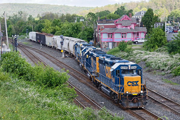 Sporting four GP40s instead of the usual pair, train B740 backs off the controlled siding at MP83 onto the yard lead with a cut of cars for the Mass Central.<br /> 6/20/2017 - 598C2425dK