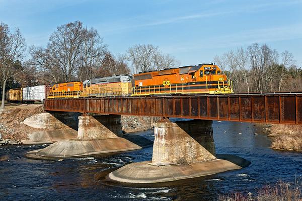 NECR train 611 crosses the bridge at Three Rivers, MA.<br /> 12/4/2017 - 598C4693dK