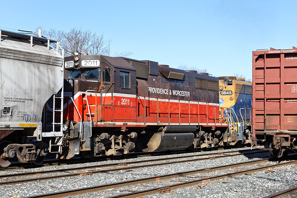 All part of the same family now - P&W 2011 works the yard in Palmer MA with NECR 3845. 3/9/2017 - 598C0672dK