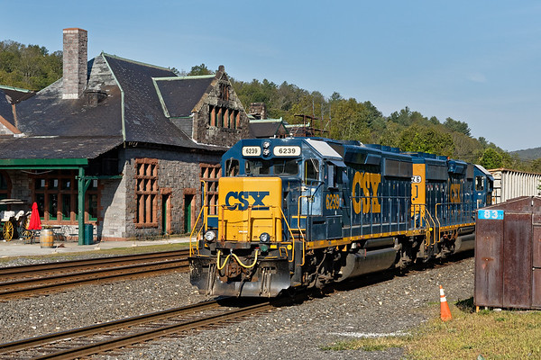 With the historic Palmer Depot as a backdrop, train B740 backs down the yard lead with a cut of cars for the Mass Central.<br /> 8/28/2017 - 598C3263dK